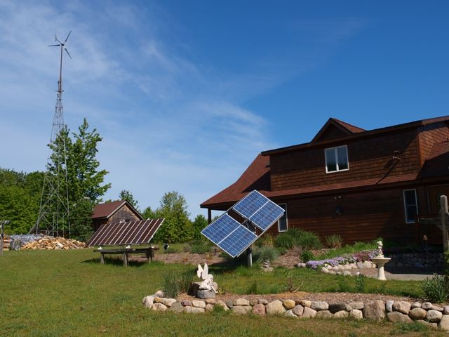 Tim Johnson's windmill and solar panels at his house in Centerville Township, which he says generate 90 percent of the energy he uses.