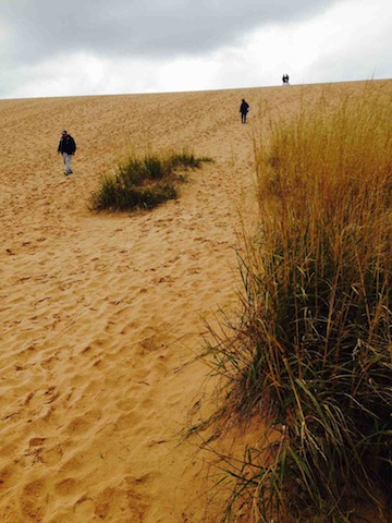 Tourists descend the Dune Climb on Thursday after the Sleeping Bear Dunes National Lakeshore officially reopened.